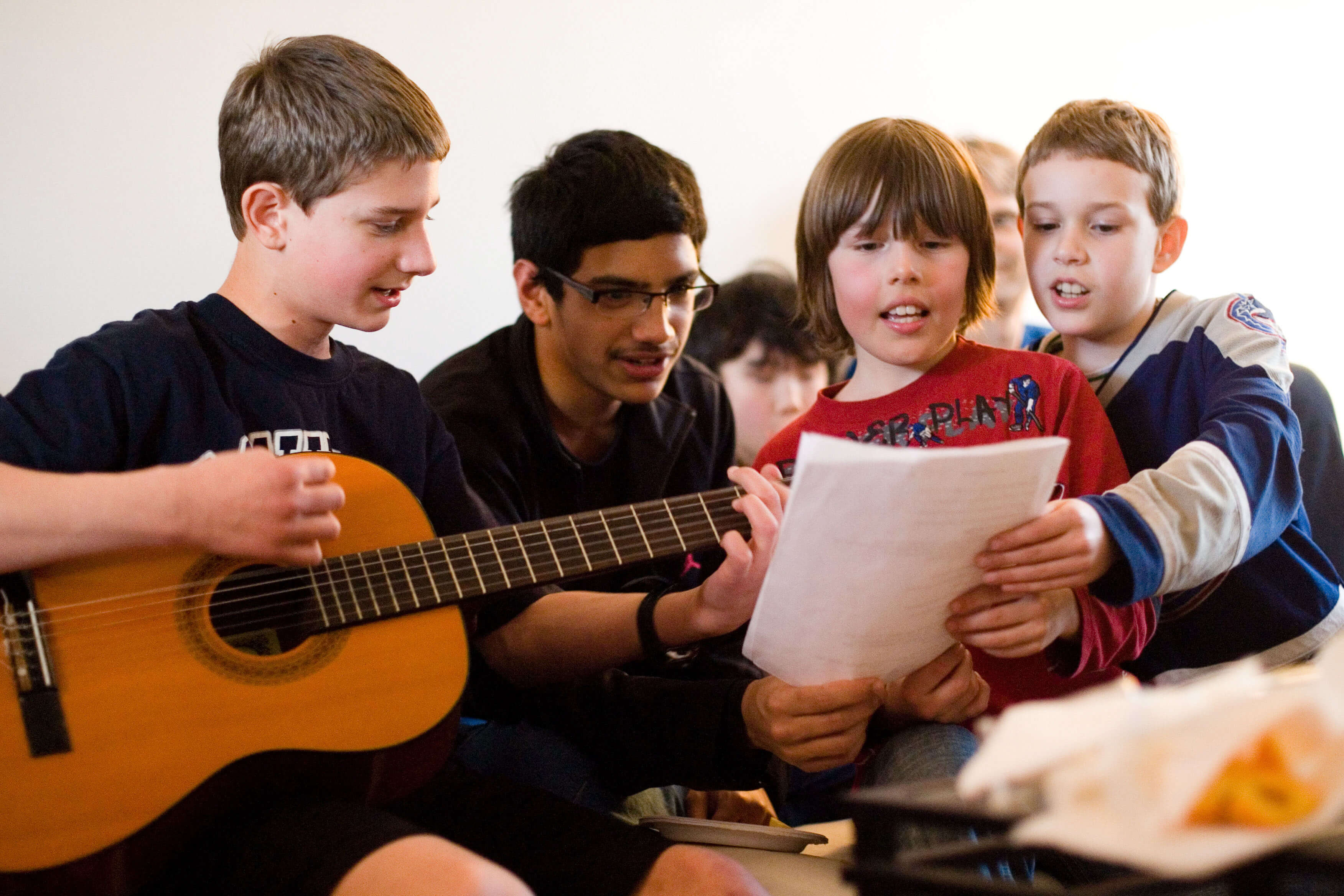 A group performing music as part of their study of the spiritual empowerment of junior youth